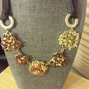 Coldwater Necklace in peach and brown tones